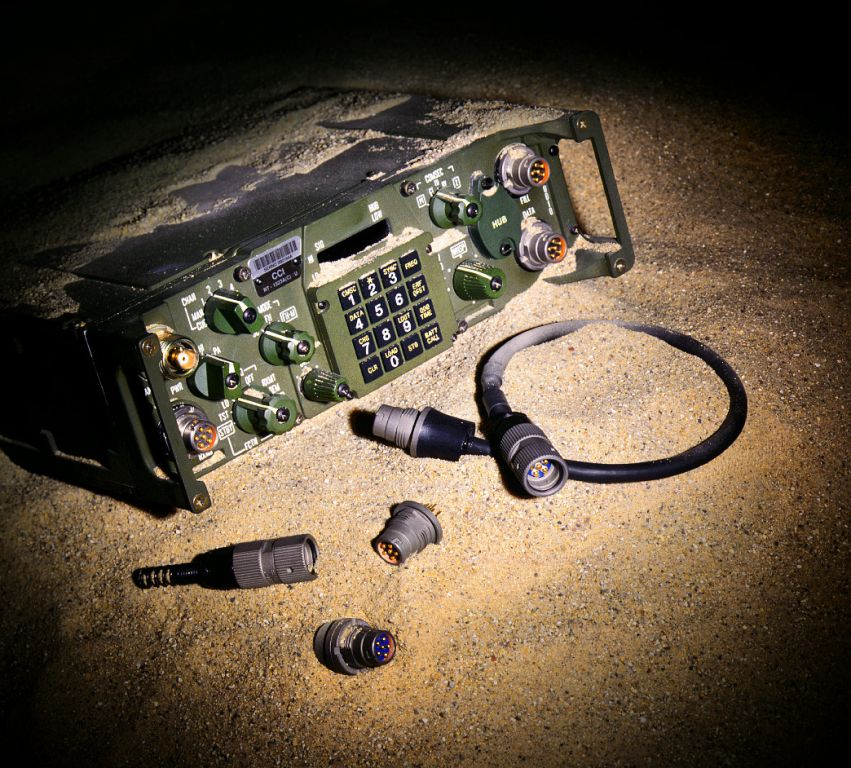 military radio in sand product photo